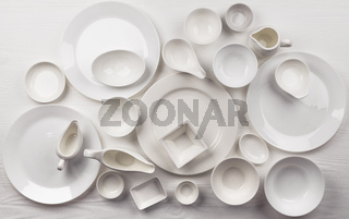 Set of empty dishware on white background with copy space