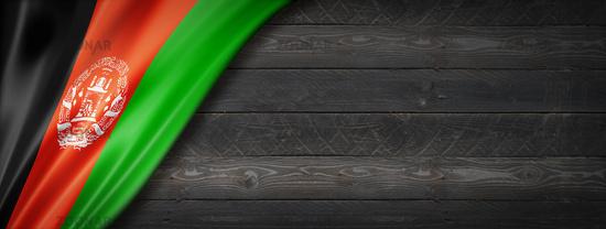 Afghan flag on black wood wall banner