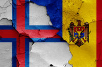flags of Faroe Islands and Moldova painted on cracked wall