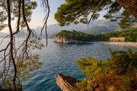 Milocer Park beside of Sveti Stefan at sunset. Budva Riviera coast, Montenegro.