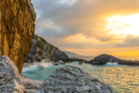 Evening Rocky Shore and Sea Surf Splashes