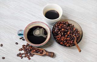 Coffee cups, coffee beans