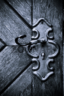 Retro keyhole in old wooden door