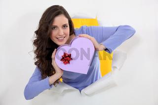 Brunette holding heart-shaped box