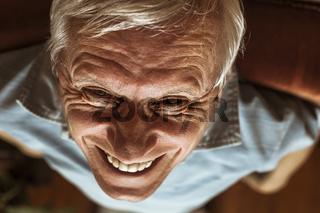 Senior man toothy laugh