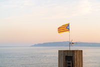 Landscape with flag in front of Les Medes islands