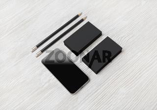 Smartphone, business cards, pencils