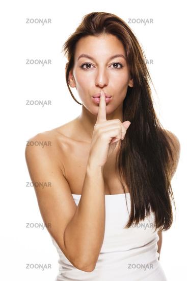 beautiful woman making shush sign