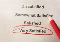 Customer satisfaction survey with Very Satisfied text circled in red pencil
