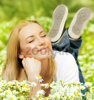 Beautiful female enjoying flower filed