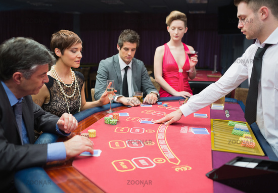 Four people playing poker