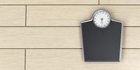 Weighing scale on wood floor