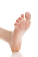 Foot with silicone separator on white background.