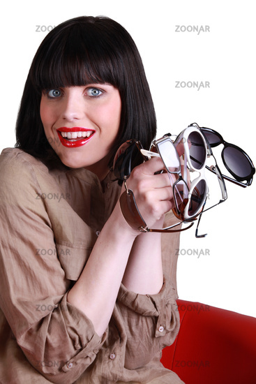 Woman with several pairs of sunglasses