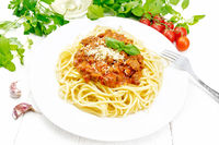Spaghetti with bolognese on light board