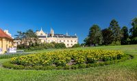 Lednice Chateau with beautiful gardens and parks on sunny summer day
