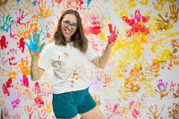 Portrait of a cute happy woman painting and having fun