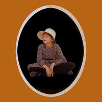 Sitting girl in frame