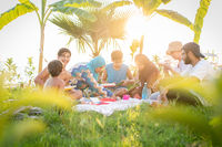 Happy family enjoying picnic on beach
