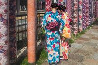 Woman in traditional clothing visiting kimono forest at Arashiyama Station in Kyoto, Japan