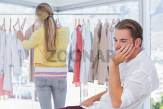 Bored man while his girlfriend is shopping