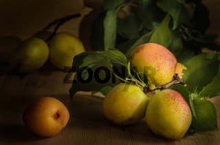 ripe juicy apricot fruits on a dark wooden background in bulk