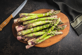 Fresh raw uncooked green asparagus.