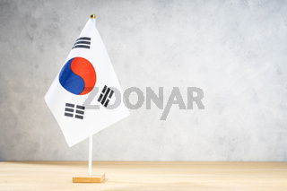 South Korea table flag on white textured wall. Copy space for text, designs or drawings