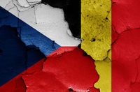 flags of Czechia and Belgium painted on cracked wall