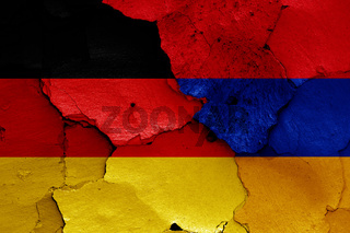 flags of Germany and Armenia painted on cracked wall