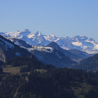 Mount Uri Rotstock and other mountains seen from a hill above Innerthal.