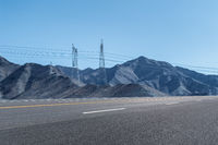highway background and power transmission tower on the mountain