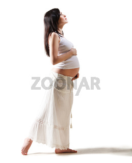 Happy young pregnant woman in white