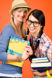 Two woman friends young students hold books