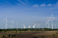 Wind turbines in front of a coal-fired power station