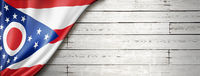Ohio flag on white wood wall banner, USA