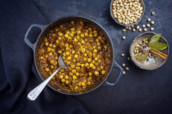 Traditional Indian chana masala curry stew with chickpeas and spices served as top view in saucepan