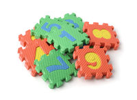 Pile of colorful foam math numbers puzzle pieces