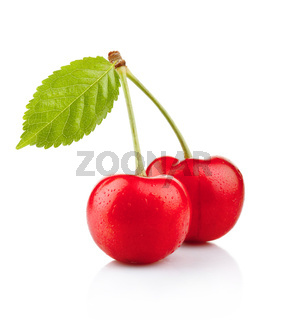 Ripe red cherry berries with green leaves isolated