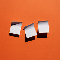 Blue sticky note paper on red background. copy space