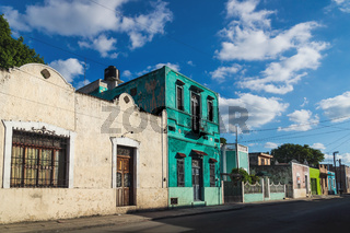 Street with colorful renovated colonial house facades in Merida, Mexico
