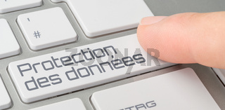 A keyboard with a labeled button - Data security in french - Protection des données
