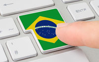 A keyboard with a labeled button - Flag of Brazil