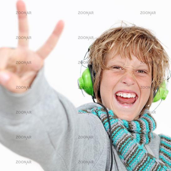 happy kid doing v sign and listening to music wear