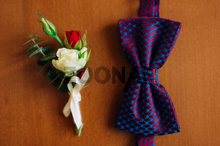 Bow tie on a wooden background