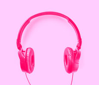Headphones on a pink background