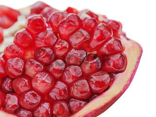 Pomegranate fruits isolated on white background. Close-up.