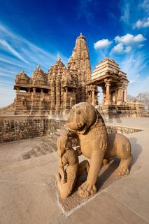 King and lion fight statue and Kandariya Mahadev temple.  Khajuraho