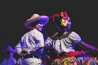 Close up of a Catrina couple at public dance performance with traditional Mexican costumes in Merida