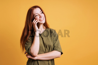 happy laughing young woman talking on smartphone or mobile cell phone